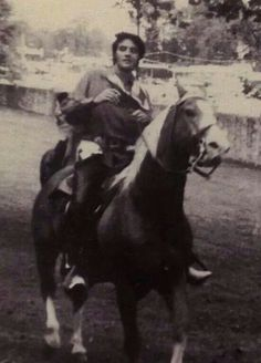 Elvis rides a horse at Graceland