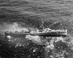Destroyer Escort USS Fiske broken in two and sinking in the North Atlantic after being torpedoed by German submarine U-804 2 August 1944.