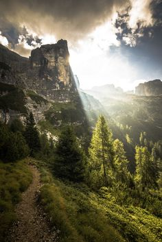 Beautiful sunrise behind a peak of the Dolomites.  The Dolomites are located in northeast Italy.  Popular year round for adventure travelers, this region offers great skiing in the winter moths, mountain climbing, hiking, cycling, base jumping, paragliding and hang gliding during the Spring, summer and early fall.