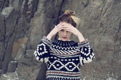 sweater with intricate design.