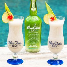 When life hands you limes, you make a Key Lime Colada. This creamy frozen drink recipe is the perfect cocktail for your day at the beach or by the pool. Blend all ingredients together. Pour into a cup rimmed with coconut flakes. Garnish with a lime wheel and a cherry. #bluechairbay #keyllimerumcream #BCBHappyHour