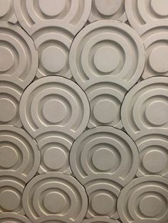 Completely interesting and beautiful. Curl concrete dimensional tile is playful yet a substantial statememt on a bathroom feature wall.
