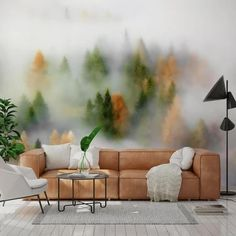 Adorn your living room walls with a misty forest wallpaper mural from Wallsauce.com! Perfect for creating a sense of serenity in your home and really bringing in a zen vibe, these wallpaper murals are great for a living room feature wall. Place behind your brown leather sofa and style with white decor pieces to brighten up the space. Add house plants to mirror the naturalistic vibe of the designs. #muralinspo #forestwallpaper #livingroomwallpaper #livingroominspo Tree Wallpaper Mural, Forest Wallpaper, Colorful Wallpaper, Room Wallpaper, Kids Wallpaper, Forest Mural, Family Room Decorating, White Decor, Wall Murals