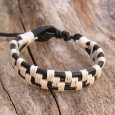 Black 3mm leather cord, woven with white hemp cord. Black 2mm leather cord used for adjustable length. This Black Leather Bracelet with White Hemp  is adjustable fits, 17.5-20.5cm, 7-8 inch wrist and just under .75 inch, 15mm wide by .25 inch, 5mm thick.