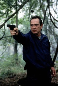 Tommy Lee Jones for the hero or villain. He's worked with Steven Seagal, Clint Eastwood, Gene Hackman, Jeff Bridges, Harrison Ford, Wesley Snipes, etc. He's perfect for the franchise if they ask him.