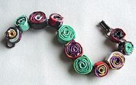 Upcycled magazine pages - coiled bracelet. I have to try this.
