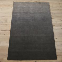 Shop ombre grey rug.   Handloomed from soft New Zealand wool, plush shades of grey run the spectrum from light to dark creating a variegated ombre effect.