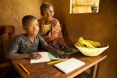 Nyaka AIDS Orphans Project Grandmother and boy study Orphan, Photo Contest, Vulnerability, Uganda, Thing 1, Learning, Children, Projects, Photos