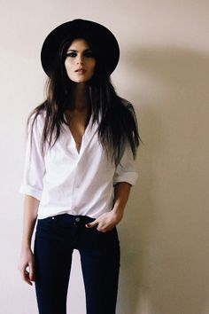 Black skinnies. Whit button down. Black hat.