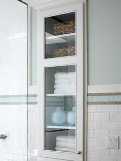 built in cabinet in between studs in bathroom - we did a smaller version of this is in the current place with frosted glass and I love it!