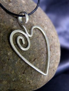 Silver Bead Pendant, hand hammered spiral heart design by Lara Owens
