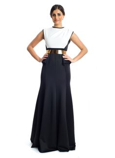 This classy and elegant maxi dress by Xela is the perfect addition to your party wear wardrobe! It features a black and white sleeveless dress with a flare cut skirt and a gold belt that add tons of glamour and feminine appeal to the any woman. Makes a great buy for social gathering.