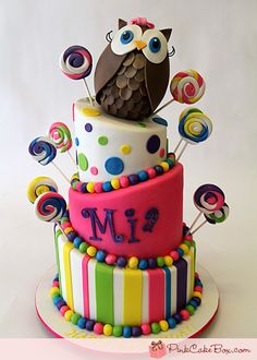 Love this cake! - I want to do a similar design for Emma's birthday this year. Only a penguin instead of an owl. :)