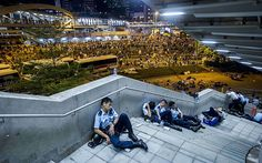 Policemen rest after pro-democracy protests in Hong Kong on September 29, 2014.
