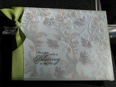 embossed vellum overlay on patterned paper makes for a quick and easy card...very pretty way to use patterned paper...