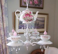 Awesome chandelier made up of tea cups, saucers & a tea pot