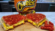 It is National Sandwich Month and I've got the mother of all sandwiches! Grilled cheese sandwiches are my absolutely fave so I decided to take it up a notch. I made a Flamin' Hot Cheeto… Grill Sandwich, Grill Cheese Sandwich Recipes, Fun Baking Recipes, Snack Recipes, Cooking Recipes, Snacks, Cheetos, Grilled Cheese Recipes, Best Grilled Cheese