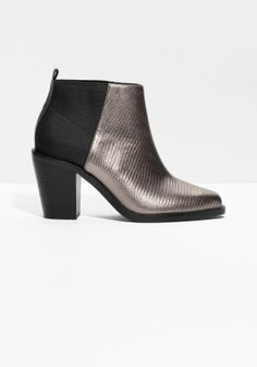 Reptile embossed leather ankle boots with elastic panels that stretches all the way to the heel.
