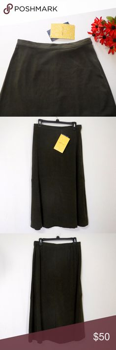 """NWT Susan Graver Maxi Skirt Size M Susan Graver Maxi Skirt Size M  Dark Green Pull On Hidden Button, Slide Hook With Zipper Closure Elastic At The Sides For A Little Stretch Factory Kick Vent In Back 97% Polyester 3% Spandex  All Measurements Posted Below are Aprox. & Taken While Laying Flat Waist:15""""(30) Length:33""""  Please Ask Any Questions You may Have Before Purchasing.  Smoke & Pet Free Home  Please Check Out My Other Items  Inv#364 Susan Graver Skirts Maxi"""