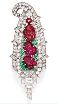 Platinum, Ruby, Diamond And Emerald Brooch  Mauboussin,   c.1930