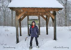 Snowshoeing is a popular winter activity in the Finger Lakes. This snowshoer has picked the Cornell Plantations for her winter trek.