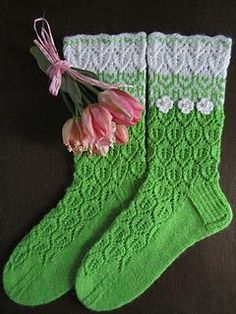 These socks were actually inspired by winters last snow and first white flowers, by longing for green. Knitted on double pointed needles, I combined lovely lace cuff with some stranded pattern and leaf-lace. Any other color instead of green would look great and shiny with white. Or maybe instead of white some other color? :)