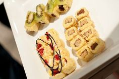 A tray of dessert sushi all made using Little Debbie snacks and fresh fruit!