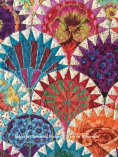 Mary used her stash of Kaffe Fassett fabrics for her stunning Clamshell Pickle quilt. There are close-up photos on the blog.