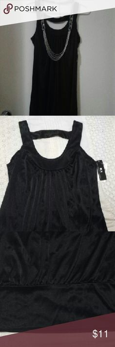 NWT black cocktail dress blouson style The perfect black cocktail dress. Satin like appearance. Scoop neckline in the front with cage back detail. Blouson style, last pic shows bandeau bottom of dress. Necklace not included BCX Dresses