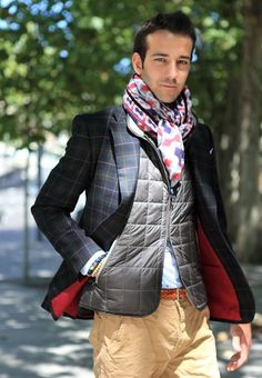Shop this look on Lookastic: http://lookastic.com/men/looks/scarf-blazer-gilet-dress-shirt-belt-chinos/9018 — Grey Print Scarf — Navy and Green Check Blazer — Grey Quilted Gilet — Light Blue Dress Shirt — Tobacco Woven Leather Belt — Khaki Chinos