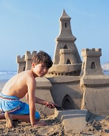 How to Build a Sand Castle: have tools: paint stirrer for sketching and smoothing; straws for blowing excess sand away; measuring spoons and melon baller for making windows; offset...