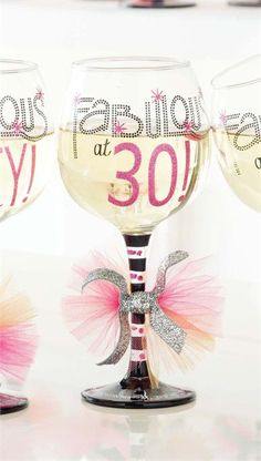 """Fabulous at 30 Wine Glass - Fabulous and 30? You deserve a festive wine glass from Mud Pie that reads """"Fabulous at 30!"""" and has glitter detail and ribbon accent on stem. Bottom of glass reads """"Wine brings out the fabulous in me!""""."""