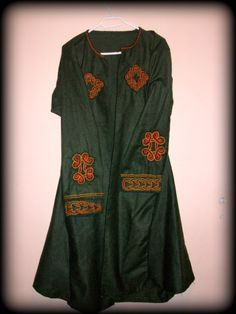 Viking kaftan   embroidery on this or are they applique?    I think it is embroidery, but that is my thing...