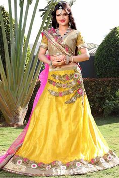 Yellow Colour Net Fabric Party Wear A Line Lehenga Choli Comes With Matching Art Silk Blouse and Net Fabric Dupatta. This Lehenga Choli Is Crafted With Embroidery Work. It Is An Party Wear Lehenga Cho...