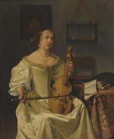 Dutch school, 17th Century A LADY ELEGANTLY ATTIRED IN A SILK DRESS PLAYING A TREBLE VIOLA DA GAMBA IN AN INTERIOR