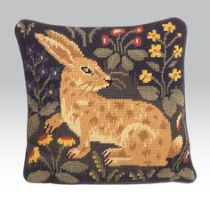 Rabbit - Ehrman Tapestry designed by Candace Bahouth. Lovely, the way the stitchery captures the wariness -