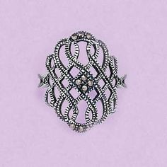 Genuine marcasites shimmer in a woven filigree sterling silver ring.
