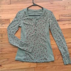 REI Mint Green Floral Thermal with thumb holes S Gently used warm thermal by REI. Size small with thumb holes on the cuffs. Good condition with a small sign of wear on the back bottom left (see last photo) REI Tops Blouses