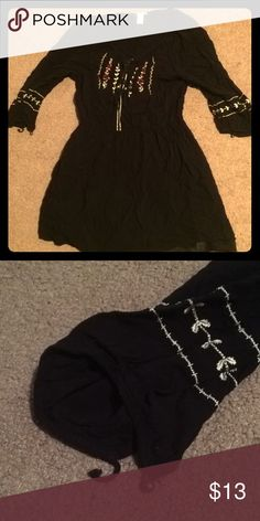 Black tunic with gold and rose details; Forever 21 This is a medium size black tunic shirt from the Forever 21 Los Angeles collection! It has been worn before, but has not been worn in the last three years! Great condition, slightly wrinkled, and one of the loops on the sleeve is torn, but easily fixed! Forever 21 Tops Tunics
