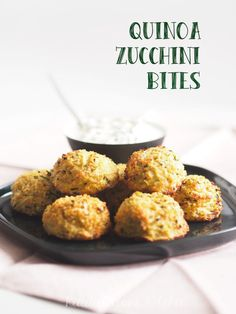 Warm quinoa zucchini bites full of healthy ingredients served with a fresh yoghurt dip.