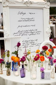 LOVE this decor! The painted white frames, the scattered posies and the calligraphy menu! Just love it! Photography by christianothstudi..., Event Planning by daughterofdesign.com, Floral & Event Design by hatchcreativestud...