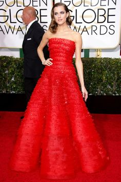 Allison Williams Wearing a sequin-dusted, multi-tiered Armani Privé gown, Allison Williams has never looked like she belonged more on the red carpet than she did during this year's Globes. ...