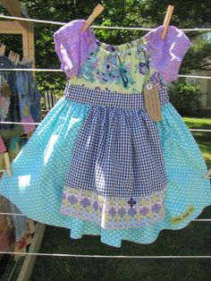 The skirt on this dress is turquoise and white. It kind of looks like mermaid scales. The apron is navy blue Apron, Peasant Dresses, Turquoise, Summer Dresses, Sewing, Trending Outfits, Children, Skirts, Cute