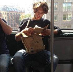 The newest internet trend is called 'Hot Dudes Reading' and it involves a bunch of hot guys reading books, magazines, and newspapers on the subway.