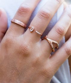 """This beautiful ring has all the qualities of being """"""""Unique yet Timeless"""""""" that we have been dreaming about!The delicate 14k Rose Gold Band has a delicate detail of five .03 carat diamonds on one sid"""