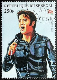 SENEGAL - CIRCA 1998. A postage stamp printed by Senegal shows image portrait of famous American singer Elvis Presley (1935-1977), circa 1998. Stock Photo