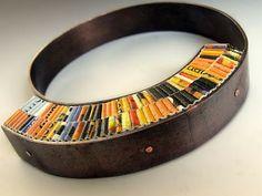 Francesca Vitali's bracelets using paper combined with metal.