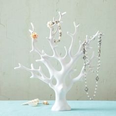 Two's Company Our Coral Tree Resin Jewelry Holder is a perfect holder for all of your treasures. Hang up your jewelry and add a feeling of the sea to your room. The Coral Tree is great on its own as a decorative accent as well. – Modish Store