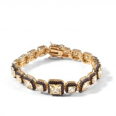 Squared canary & brown bracelet EDITORS' NOTES  This sophsticate and delicate style is perfect for every kind of event. Crafted from squared canary stones surrounded from sparkling brown cubic zirconia, which has been intricately handcrafted for flawless results, set on a gold plated sterling silver frame. http://www.ultimaedizione.com/shop/en/bracelets-and-bangles/327-squared-canary-brown-bracelet.html