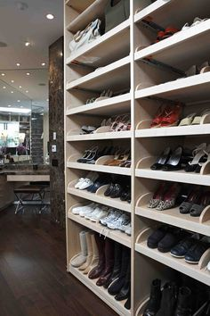 this dressing room has a shoe closet with pull out shelves